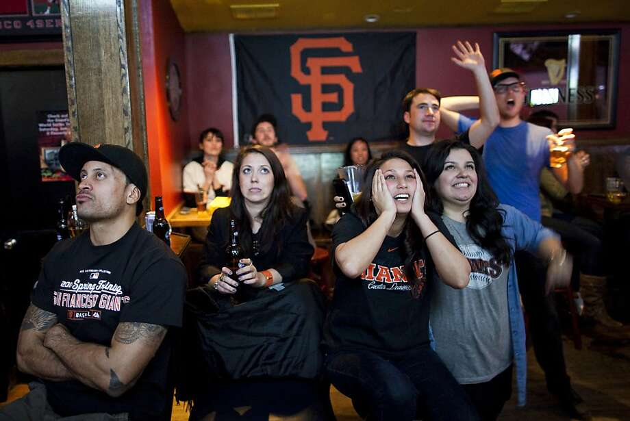 NEW YORK  --  APRIL 03, 2011:   Sergio Dominguez (L), who moved to NYC 7 years ago from San Francisco's Mission District, Sarah Baky (2R), Steph Castro (R), and other SF Giants fans gather at Finnerty's  to watch their team play the LA Dodgers on April 03, 2011 in New York City.   Finnerty's has become a hang out for SF Giants fans in NYC. Photo: Michael Nagle, Special To The Chronicle