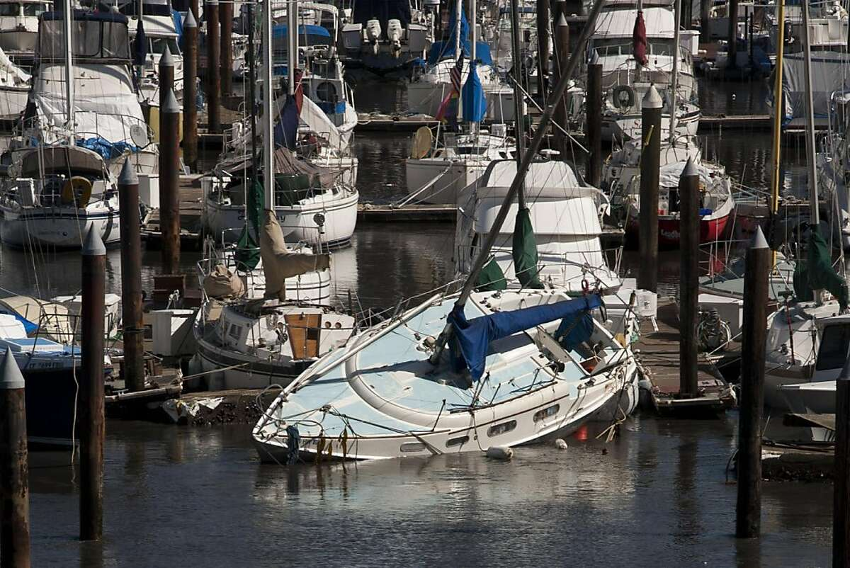 Boats docked at Santa Cruz Harbor slam against each other with each new surging wave from the tsunami that began pounding California's coast on Friday, March 11, 2011 in Santa Cruz, Calif.