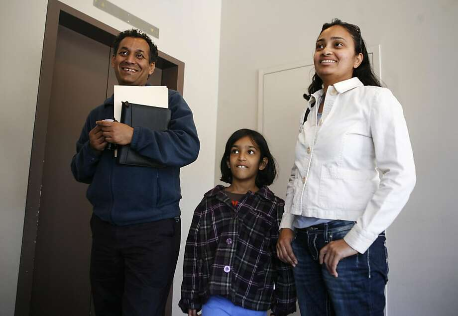 Raj Raman, left, and wife, Aarthi Raj, right, visited the US Passport Office at 95 Hawthorne street in San Francisco to get a passport for their 6-year-old daughter Neha Raj, center, before the possibility of a federal government shutdown late Friday night. on Friday April 8, 2011. Photo: Anna Vignet, The Chronicle