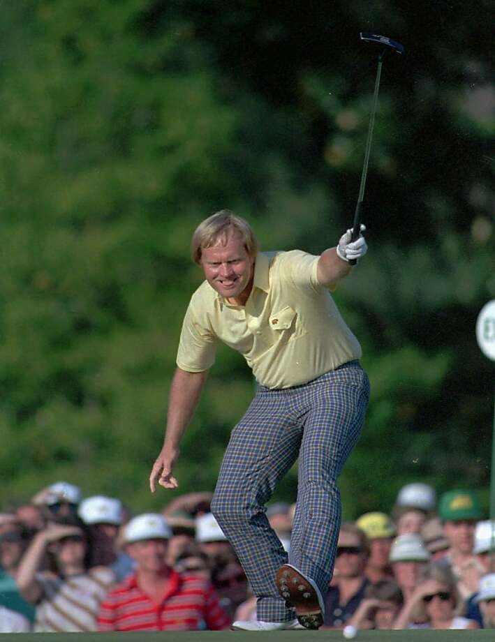 FILE--Jack Nicklaus takes pleasure in watching his putt drop for a birdie on the 17th hole at Augusta National Golf Course on April 13, 1986. The shot gave him the lead and ultimately, his sixth Masters title. Forty-six years old, winner of only two tournaments the previous five years, he came to Augusta National with little hope of winning. Even after he shot a 69 in the third round, he wasn't among the leaders. But Nicklaus began one of the great charges in Masters history, capped off by an eagle-birdie-birdie-par streak on the final four holes. To this day, his one-shot victory over Greg Norman and Tom Kite might be the most memorable tournament in Augusta history, and it turned out to be the last victory for Nicklaus on the regular PGA Tour.(AP Photo/phil sandlin) Photo: Phil Sandlin, Associated Press
