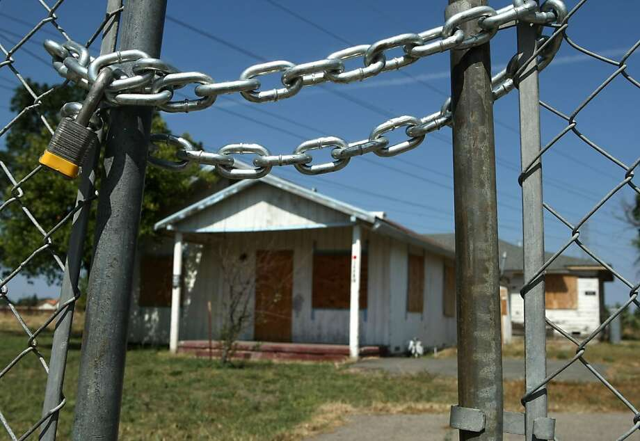 An abandoned home stands behind a padlocked gate in Stockton in 2008. Photo: Justin Sullivan, Getty Images