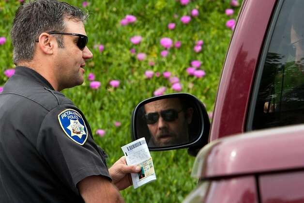 Petaluma Police Officer Burt Walker talks with a cell phone violator on  Petaluma Blvd on  April 5, 2011 in Petaluma, Calif.  Photograph by David Paul Morris/Special to the Chronicle Photo: David Paul Morris, Special To The Chronicle