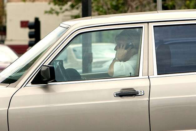 A driver uses her cell phone as they drive on  Petaluma Blvd on  April 5, 2011 in Petaluma, Calif. Photo: David Paul Morris, Special To The Chronicle
