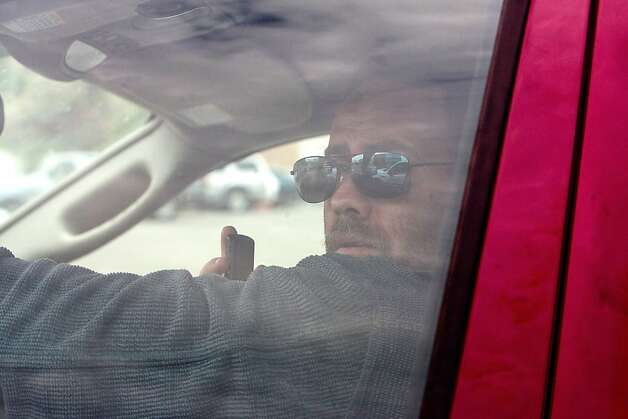 A driver uses his cell phone as they drive on  Petaluma Blvd on  April 5, 2011 in Petaluma, Calif. Photo: David Paul Morris, Special To The Chronicle