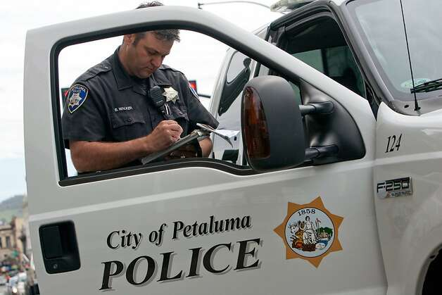 Petaluma Police Officer Burt Walker writes a ticket for cell phone violation on  Petaluma Blvd on  April 5, 2011 in Petaluma, Calif. Photo: David Paul Morris, Special To The Chronicle