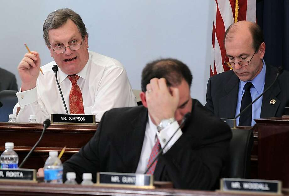 Rep. Michael Simpson, on left, R-Idaho – Simpson voted with his party