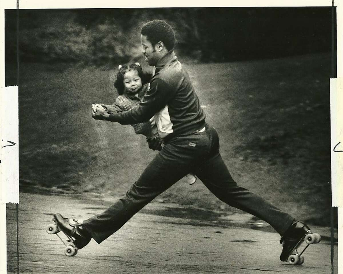 In this 1986 photo, Dave Miles Jr. skates with his then-2-year-old daughter Melanie. Miles heads the California Outdoor Rollerskating Association and Melanie is a skate dancing champion.