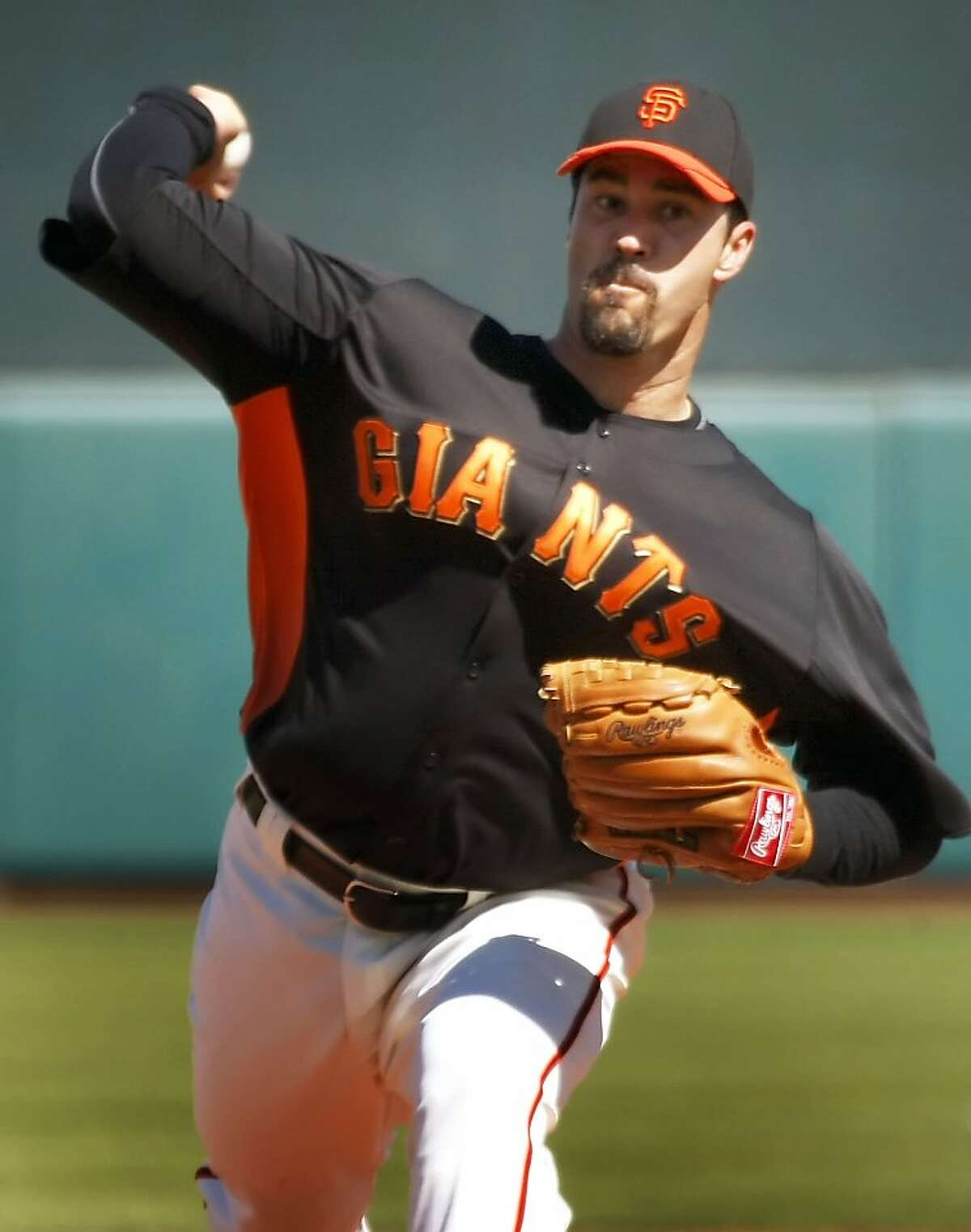 San Francisco Giants starting pitcher Jeff Suppan throws to the Milwaukee Brewers during the first inning of a spring training baseball game at Scottsdale Stadium in Scottsdale, Ariz. Friday, March 4, 2011.