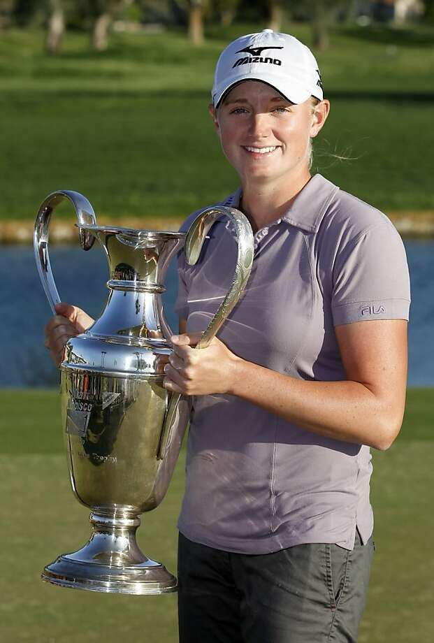 Stacy Lewis holds the trophy after winning the LPGA Kraft Nabisco Championship golf tournament in Rancho Mirage, Calif., Sunday, April 3, 2011. Photo: Chris Carlson, AP