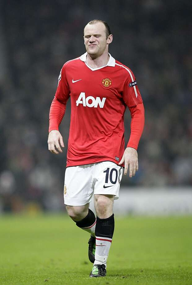 Manchester United's Wayne Rooney reacts against Marseille during their Champions League first knockout stage second leg soccer match at Old Trafford, Manchester, England, Tuesday March 15, 2011. Photo: Jon Super, AP