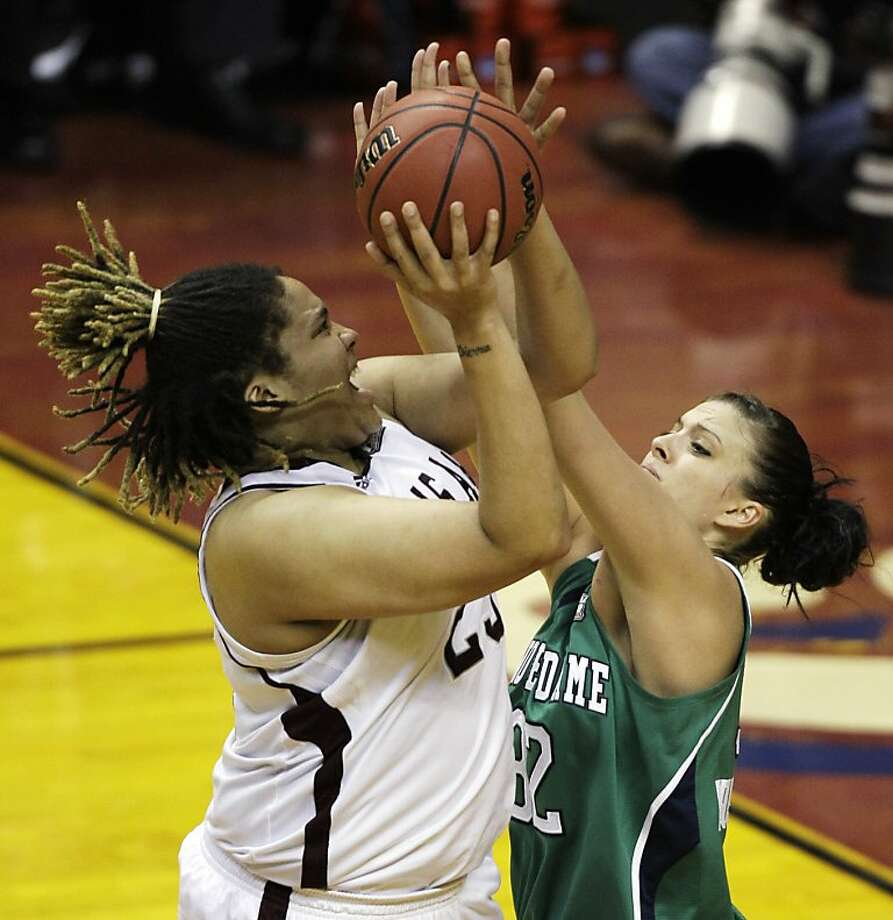 Texas A&M's Danielle Adams, left, shoots over Notre Dame's Becca Bruszewski in the first half of the women's NCAA Final Four college basketball championship game in Indianapolis, Tuesday, April 5, 2011. Photo: Amy Sancetta, AP