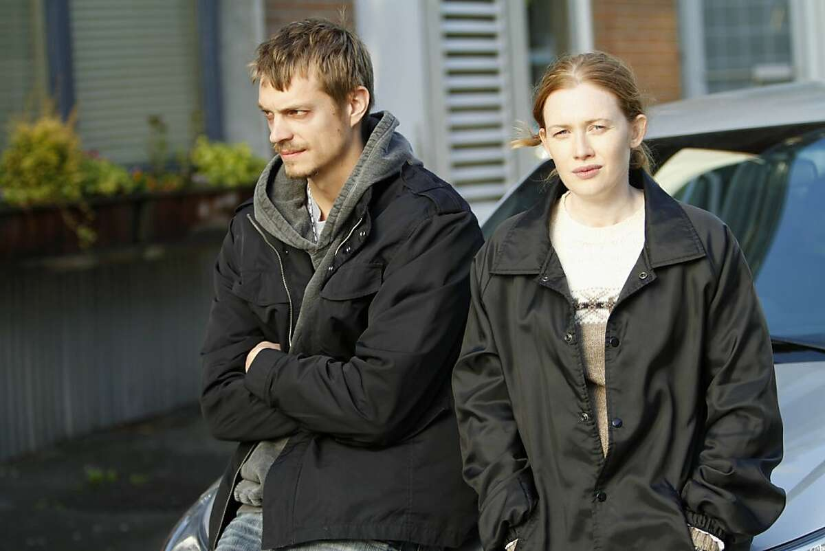 In this publicity image released by AMC, Mireille Enos portrays Detective Sarah Linden, right, and Joel Kinnaman portrays Detective Stephen Holder in a scene from the AMC original series