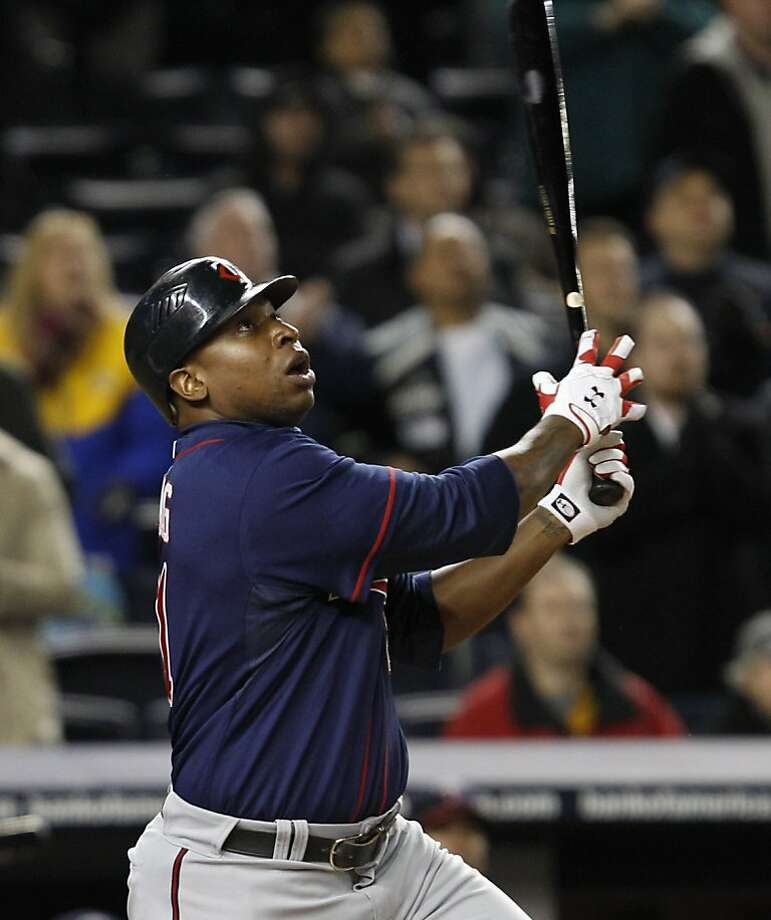 Minnesota Twins' Delmon Young watches his eighth-inning, three-run double off New York Yankees relief pitcher David Robertson in a baseball game at Yankee Stadium in New York, Tuesday, April 5, 2011. Photo: Kathy Willens, AP