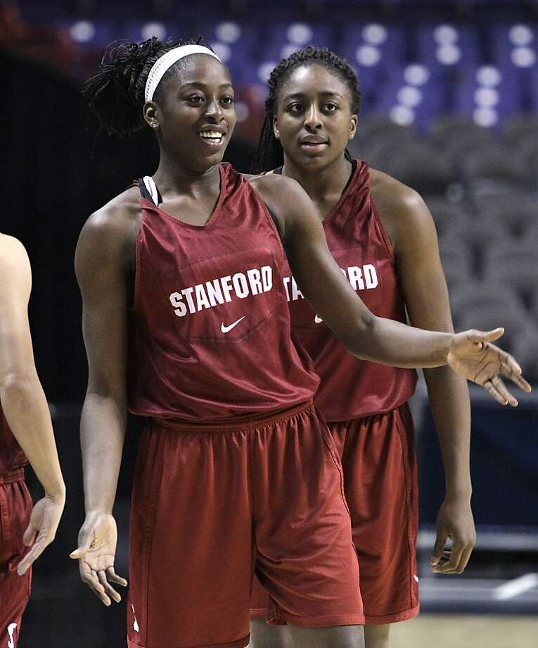 Stanford's Chiney Ogwumike, left, and her sister Nnemkadi Ogwumike wait during a drill at practice for an NCAA women's college basketball tournament regional semifinal, Friday, March 25, 2011, in Spokane, Wash. Stanford plays North Carolina Saturday. Photo: Elaine Thompson, AP