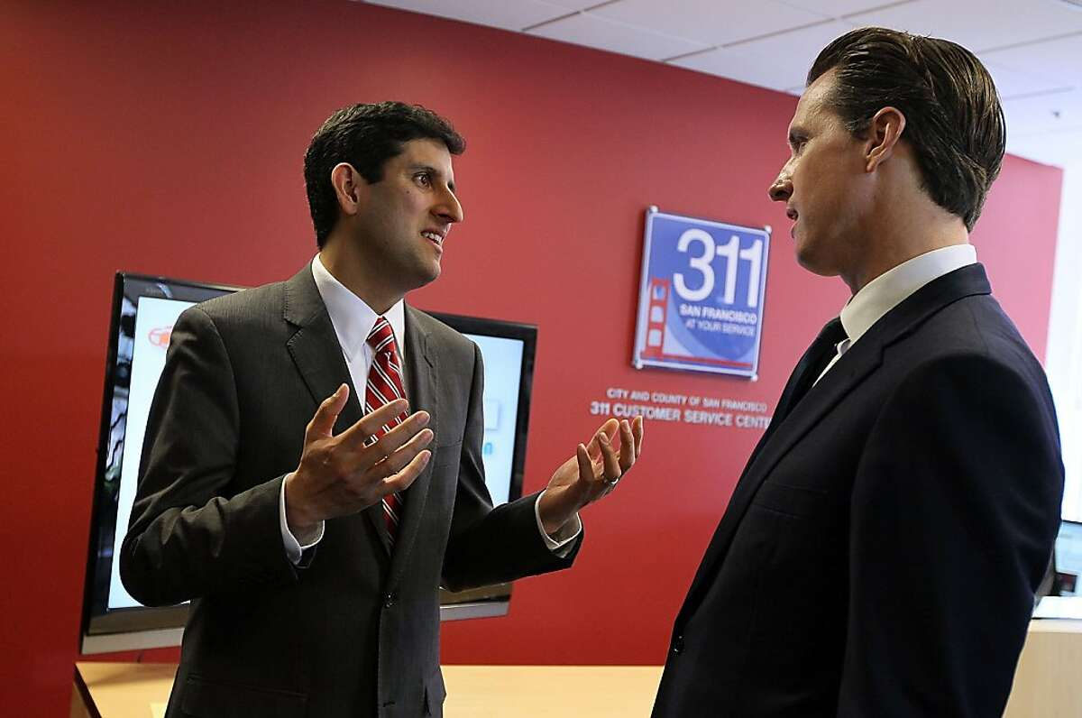 SAN FRANCISCO - MARCH 03: U.S. Chief Information Officer Vivek Kundra (L) talks with San Francisco Mayor Gavin Newsom after a press conference announcing the launch of a national initiative to open 311 customer service centers to developers March 3, 2010in San Francisco, California. San Francisco Mayor Gavin Newsom and U.S. Chief Information Officer Vivek Kundra launched the national Open 311 Application Programming Interface (API) which will allow software developers to create web applications that will allow the general public to make service requests via smart phones directly to 311 systems bypassing often inundated call centers.