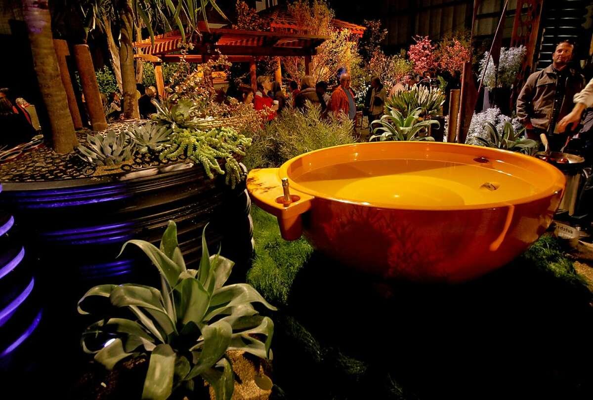 An orange hot tub graces the design of Jeffery Gordon Smith Landscape Architecture, creator of the garden