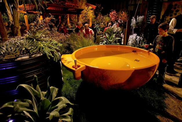 "An orange hot tub graces the design of Jeffery Gordon Smith Landscape Architecture, creator of the garden ""PI R Squared"", at the San Francisco Flower and Garden show at the Event Center on Saturday Mar. 26, 2011, in San  Mateo, Ca. Photo: Michael Macor, The Chronicle"