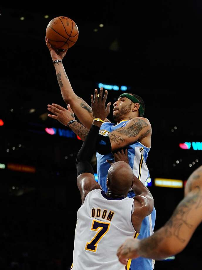 LOS ANGELES, CA - APRIL 03:  Kenyon Martin #4 of the Denver Nuggets scores a basket against Lamar Odom #7 of the Los Angeles Lakers during the second quarter of the NBS basketball game at Staples Center on April 3, 2011 in Los Angeles, California. NOTE TOUSER: User expressly acknowledges and agrees that, by downloading and or using this photograph, User is consenting to the terms and conditions of the Getty Images License Agreement. Photo: Kevork Djansezian, Getty Images
