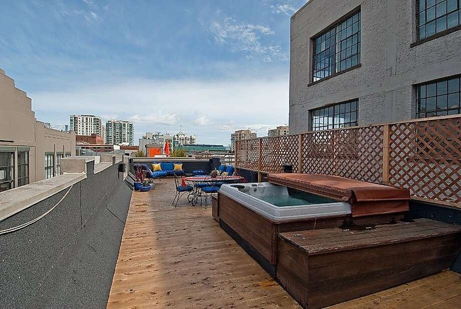 Accessed from one of the condo's mezzanines, the rooftop deck comes with a hot tub, gas grill and room for a wet bar. Photo: OpenHomesPhotography.com