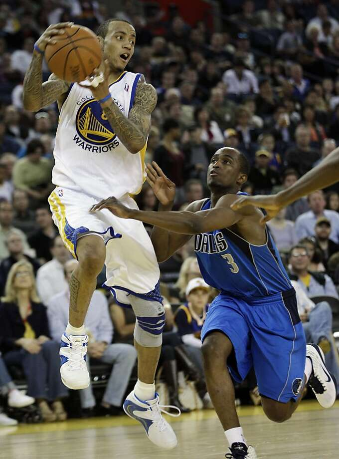 Golden State Warriors' Monta Ellis (8) is defended by Dallas Mavericks' Rodrigue Beaubois (3) during the second half of an NBA basketball game in Oakland, Calif., Saturday, April 2, 2011. Golden State won, 99-92. Photo: Marcio Jose Sanchez, AP