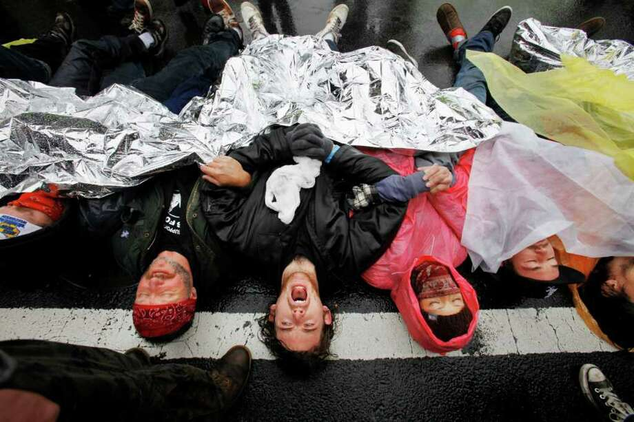 JACQUELYN MARTIN : ASSOCIATED PRESS  ANTI-LOBBY: Occupy DC protesters lay across K Street, the home of many U.S. lobbying firms, before being arrested for blocking the thoroughfare Wednesday. Photo: Jacquelyn Martin / AP