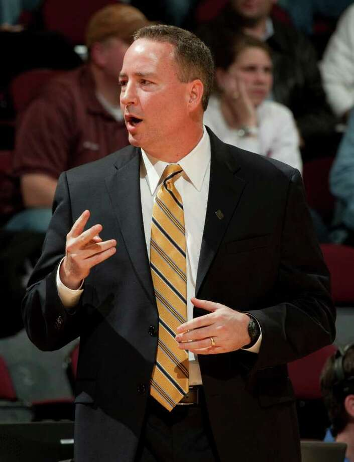 Texas A&M head coach Billy Kennedy directs his team during the second half of an NCAA college basketball game against Sam Houston State, Wednesday, Dec. 7, 2011, in College Station, Texas. Texas A&M defeated Sam Houston State 64-37. (AP Photo/Dave Einsel) Photo: Dave Einsel, Associated Press / FR43584 AP