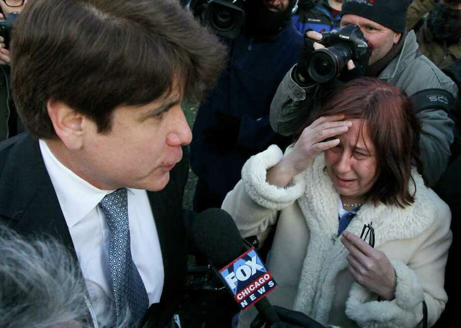 Former Illinois Gov. Rod Blagojevich, left, returns home and talks with an unidentifield crying supporter in Chicago, Wednesday, Dec. 7, 2011, after he was sentenced by Judge James Zagel to 14 years in prison for his convictions on 18 corruption counts, including trying to to auction off President Barack Obama's old Senate seat.   (AP Photo/Charles Rex Arbogast) Photo: Charles Rex Arbogast