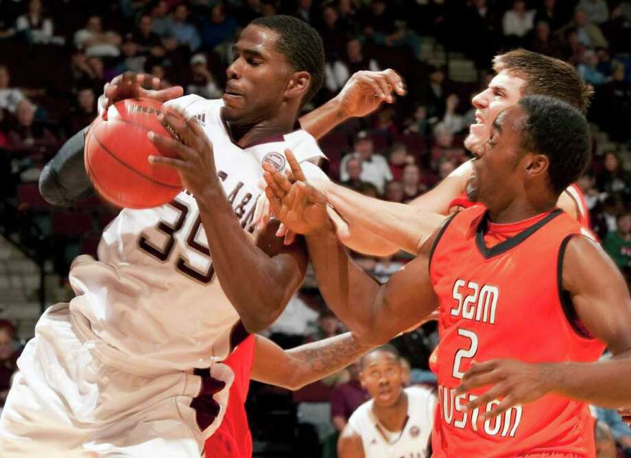 Texas A&M's Ray Turner, who had 15 points and 10 rebounds, (35) grabs an offensive rebound from Sam Houston State's Marquel McKinney. Photo: AP