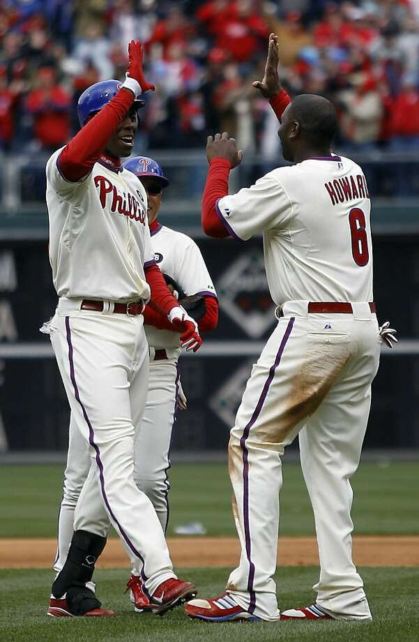 Philadelphia Phillies' John Mayberry Jr., left, celebrates with Ryan Howard after hitting the game-winning RBI-single off Houston Astros' Brandon Lyon in the ninth inning of a baseball game, Friday, April 1, 2011, in Philadelphia. The Phillies won 5-4. Photo: Matt Rourke, AP