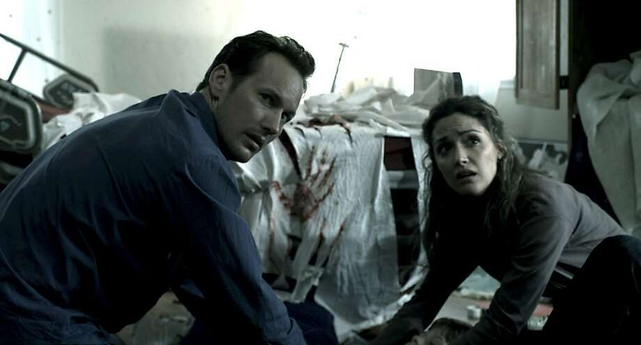 "In this film publicity image released by Film District, Patrick Wilson, left, and Rose Byrne are shown in a scene from ""Insidious."" Photo: AP"