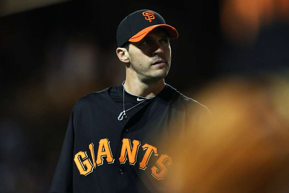 San Francisco Giants starting pitcher Barry Zito looks up at the score board as he walks off the field at the end of the second inning during their night game with the Angeles Dodgers at Glendale Stadium in Glendale, Ariz. Friday, March 4, 2011. Photo: Lance Iversen, The Chronicle