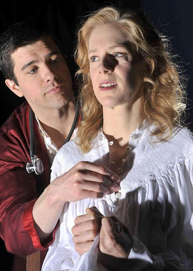 John (Thomas Gorrebeeck) unbuttons Alma's (Beth Wilmurt) nightgown in Aurora Theatre Company's production of The Eccentricities of a Nightingale Photo: David Allen