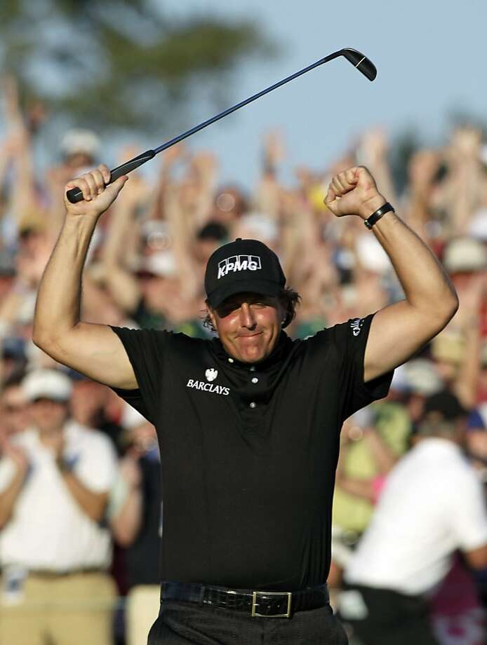 Phil Mickelson celebrates on the 18th green after winning the Masters golf tournament in Augusta, Ga., Sunday, April 11, 2010. Photo: Morry Gash, AP