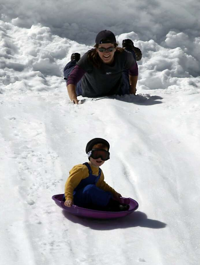 Troy Taylor from Napa California lauches his three-year-old son Collin down a hill at a snow park atop Echo Summit Calif., Wednesday, March.30, 2011. Photo: Lance Iversen, The Chronicle
