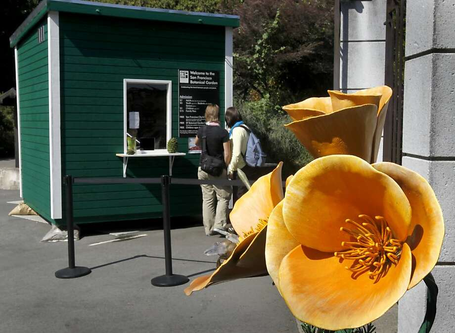 Park visitors review the admission fees on a new ticket booth at the Strybing Arboretum and botanical garden at Golden Gate Park in San Francisco, Calif. on Thursday, Sept. 9, 2010. Last month, Rec and Park officials began charging out-of-town residents a fee to enter the garden and forced city dwellers to provide proof of residency to gain free entry. Photo: Paul Chinn, The Chronicle