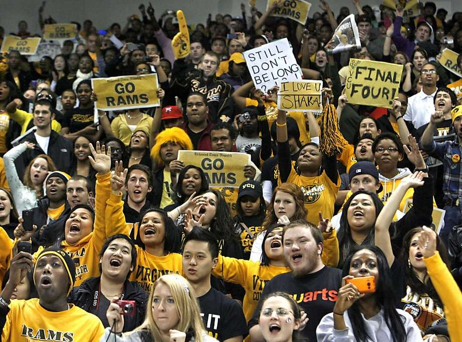 VCU fans cheer as the Rams enter the Siegel Center in Richmond, Va., March 28, around 1:30 a.m. after returning from their NCAA win over Kansas, putting them in the NCAA Final Four. Photo: P. Kevin Morley, AP
