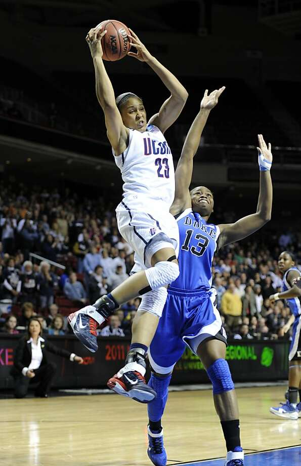Connecticut forward Maya Moore shoots over Duke guard Karima Christmas in the first half of an NCAA women's college basketball tournament regional final, Tuesday, March 29, 2011, in Philadelphia. Photo: Barbara Johnston, AP
