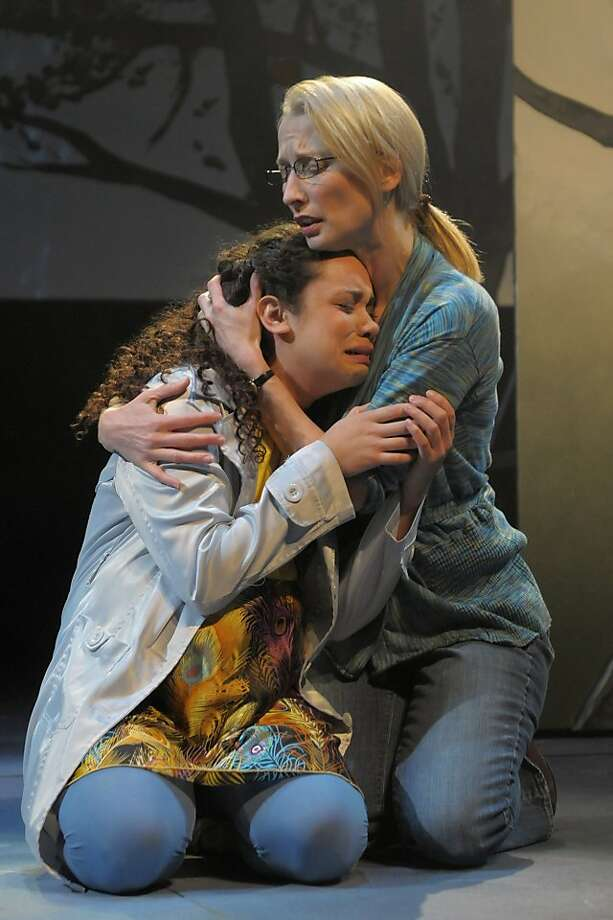 """Millie (Kathryn Tkel, left) is comforted by Olivia (Carrie Paff, right) in the 21st century part of Karen Zacarias' """"Legacy of Light"""" at San Jose Repertory Photo: Kevin Berne"""