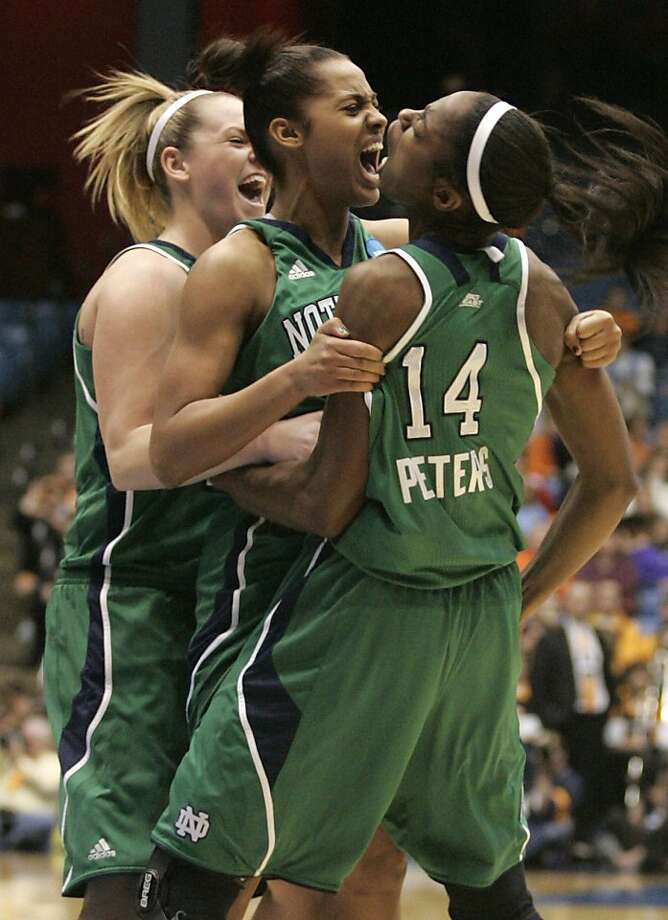 Notre Dame players, left to right, Brittany Mallory, Skylar Diggins, and Devereaux Peters celebrate late in the second half of Notre Dame's 73-59 win over Tennessee in an NCAA women's college basketball tournament regional final, Monday, March 28, 2011, in Dayton, Ohio. Photo: Skip Peterson, AP