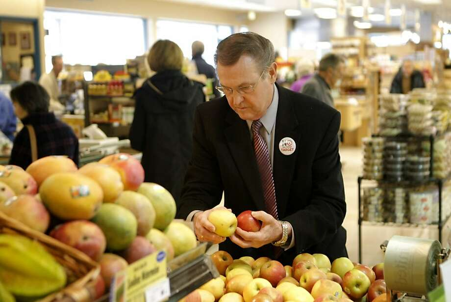 Bill Daniels, owner of United Market in San Rafael, rearranges a produce display at the United Market. Daniels is leading the opposition against a Target opening near United Market in San Rafael, Calif., on Friday, March 25, 2011. Photo: Thomas Levinson, The Chronicle