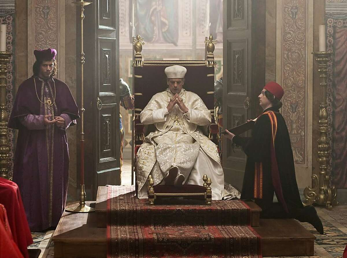In this publicity image released by Showtime, Jeremy Irons portrays Rodrigo Borgia, Pope Alexander VI, and Francois Arnaud portrays his son Cesare Borgia, left, in the Showtime original series,