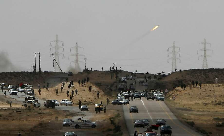 Libyan rebels fire a rocket towards forces loyal to Moamer Kadhafi during street battles near the eastern town of Brega on March 31, 2011. Photo: Mahmud Hams, AFP/Getty Images