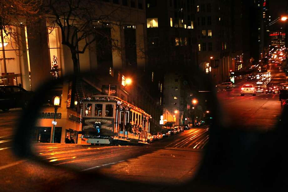 The cable car  taking it's run on California St. heading toward the Embarcadero in San Francisco, Calif., on Friday night, December 17, 2010.  Muni will shut down the California street cable car line in January for six months while equipment and tracks are ripped up and replaced. Photo: Liz Hafalia, The Chronicle