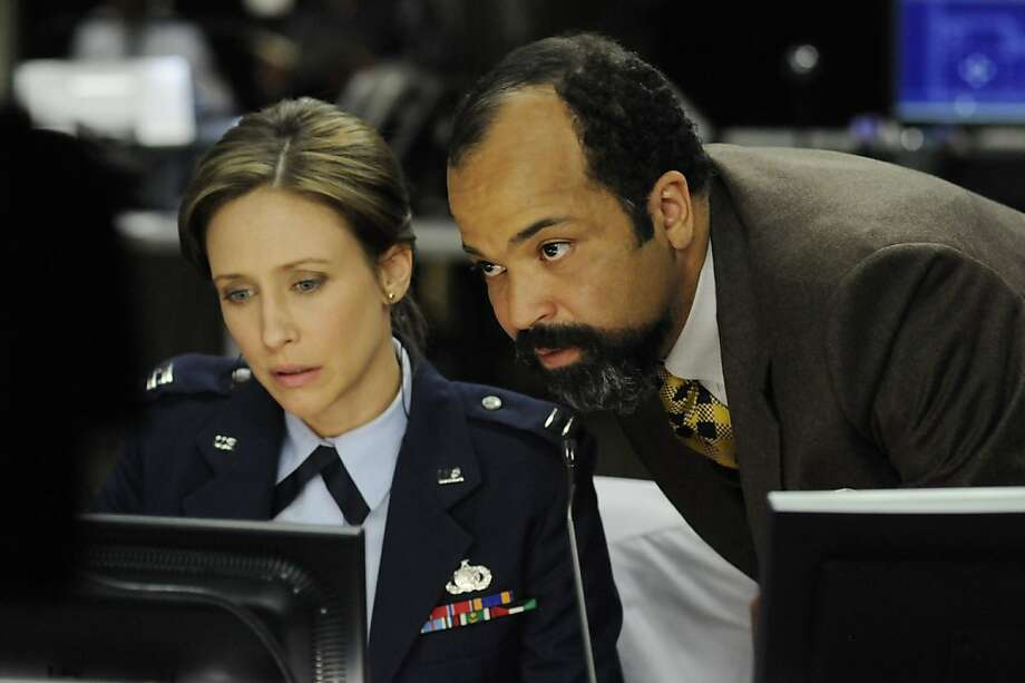 "In this film publicity image released by Summit Entertainment, Vera Farmiga, left, and Jeffrey Wright are shown in a scene from ""Source Code."" Photo: Jonathan Wenk, AP"