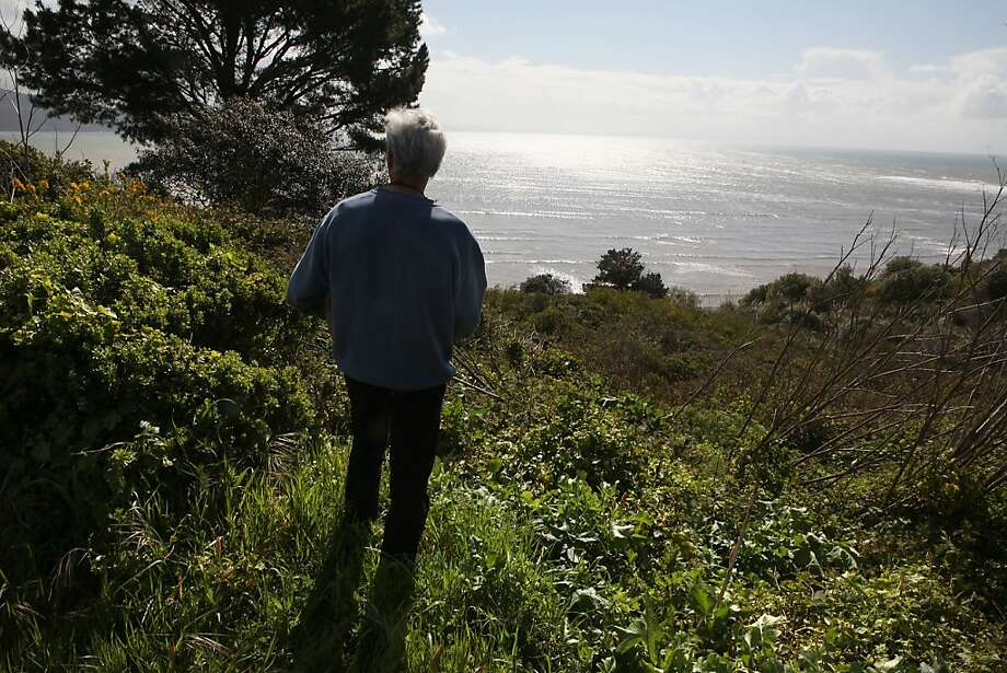 A resident stands on a bluff  on Ocean Parkway overlooking Duxbury Reef in Bolinas, Calif., on Monday, March 21, 2011.  This 47.5 acre parcel of land below is advertised at nearly $4 million dollars but is not suited for housing development. Photo: Liz Hafalia, The Chronicle