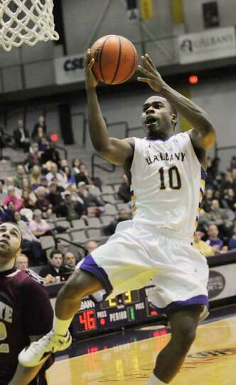 Mike Black of UAlbany drives to the basket during a basketball game against Colgate on Wednesday, De