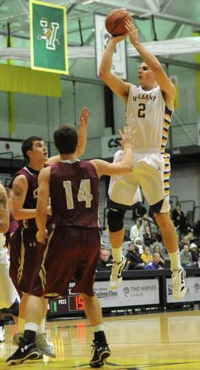 UAlbany's Logan Aronhalt goes up for a jump shot during a basketball game against Colgate on Wednesd