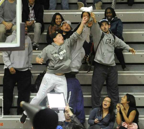 UAlbany fans try to grab a t-shirt during a time out in a basketball game against Colgate on Wednesd