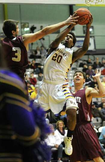 Gerardo Suero of UAlbany drives to the basket during a basketball game against Colgate on Wednesday,