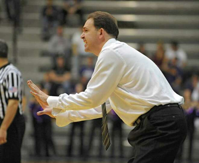 UAlbany Head Coach Will Brown yells from the sideline during a basketball game against Colgate on We